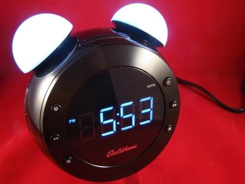 Futuristic alarm clock wears a retro face