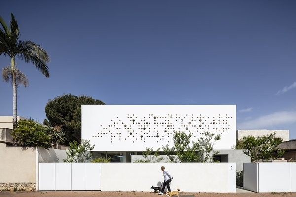 An Interior Designer's House in Israel Sports a Playful, Perforated Facade