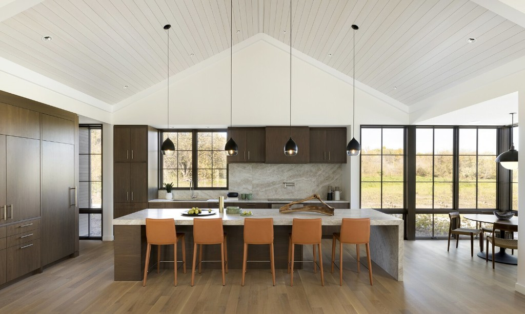 A Grove of Century-Old Trees Lend an Ethereal Backdrop to a Modern Rambler in North Dakota