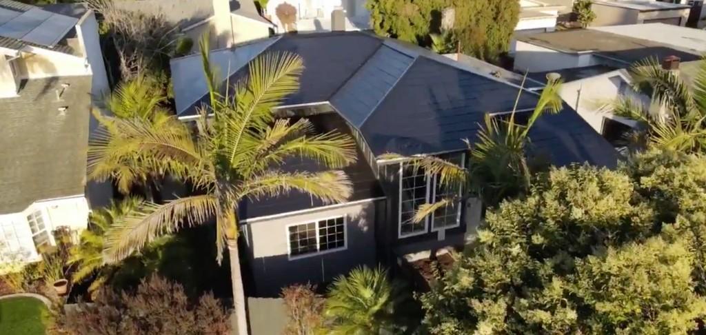 A Tesla Solar Roof system is deployed for under $30,000 - Electrek