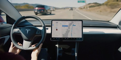 Tesla releases update with more power, automatic navigation, and more