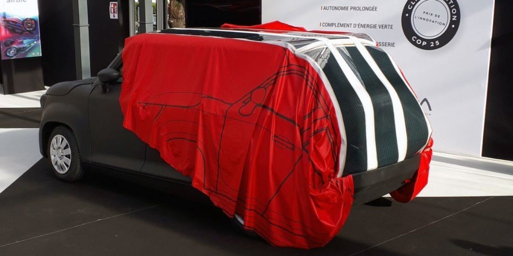 Watch this wild video of a retractable solar EV-charging car cover - Electrek