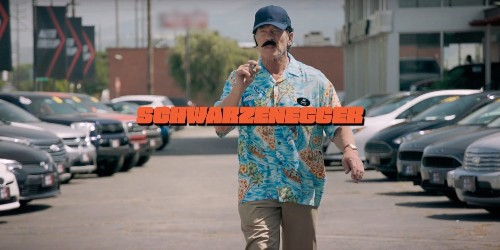 Watch a disguised Arnold Schwarzenegger try to sell gas cars to prospective EV customers