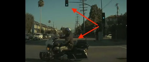Tesla Autopilot safety feature helps save cop running a red light