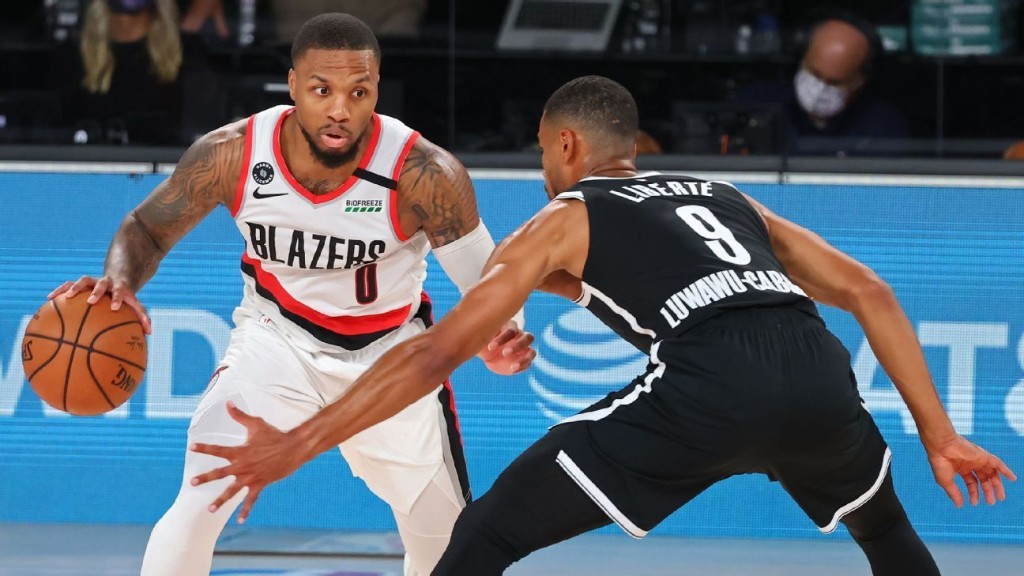 Damian Lillard, Trail Blazers escape with win vs. Nets to reach play-in round