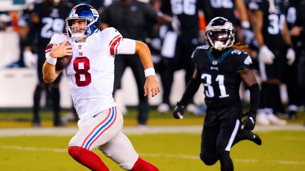 Tripped up: Giants' Daniel Jones falls on a breakaway to the end zone
