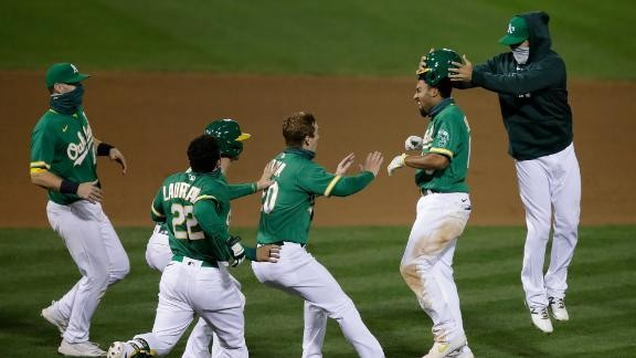 A's hold off Astros in 13th inning for seventh straight win