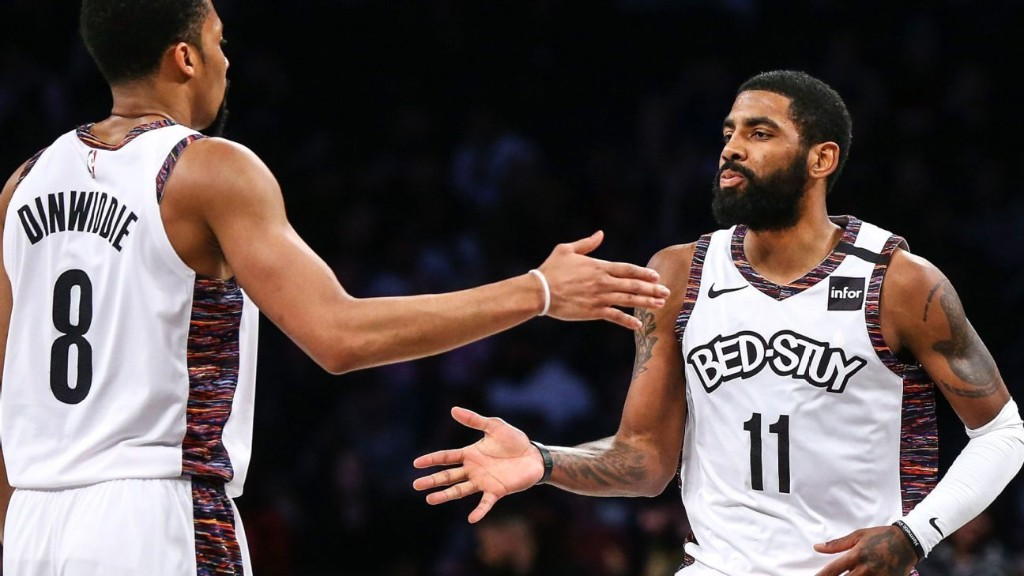 Kyrie signs Nets' jersey salvaged from fire for fan