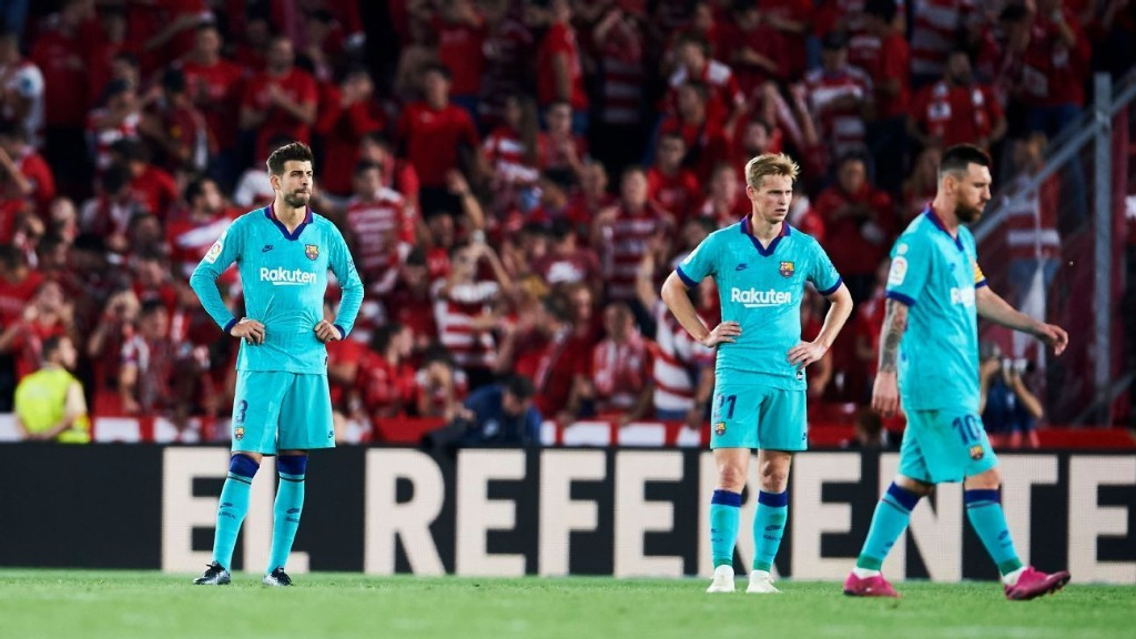 Barca cut salaries as financial struggles grow