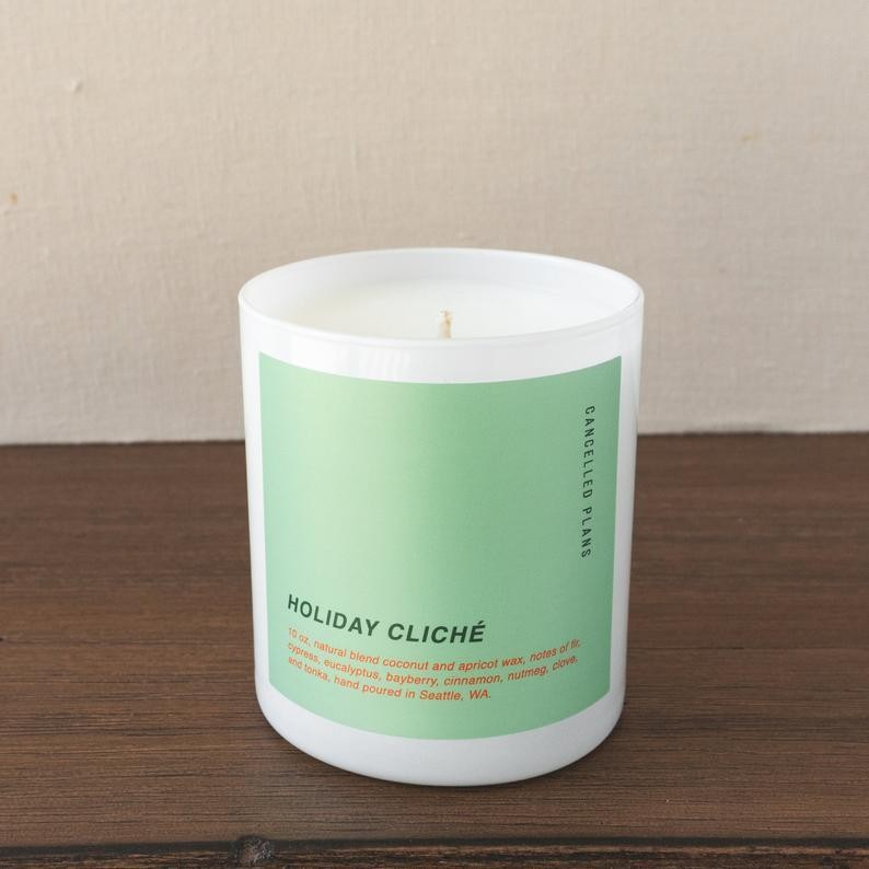 Holiday candle with notes of fir, cypress, plum and more