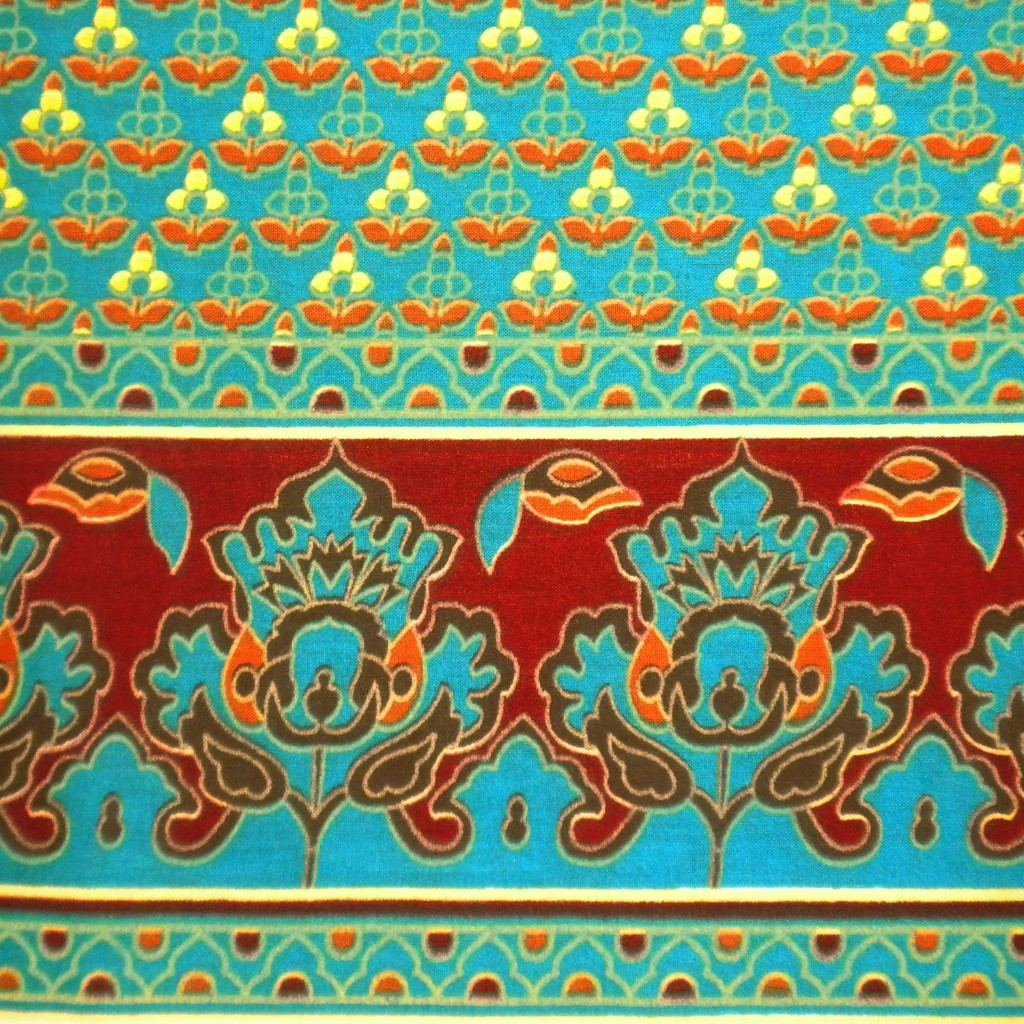 http://www.etsy.com/listing/85857066/cotton-fabric-print-small-motifs-on-teal