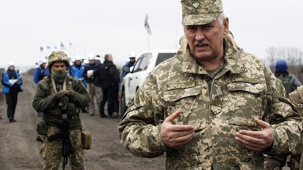 Ukraine and Russian-backed rebels begin troop withdrawal in eastern regions