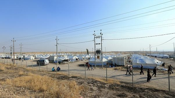 Hundreds of thousands flee Turkey's incursion into northern Syria