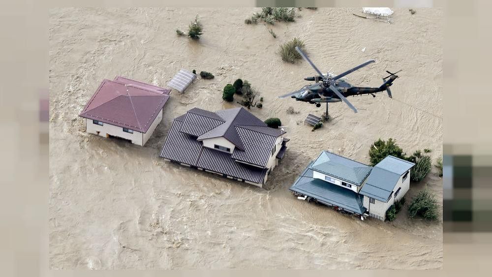 Storm-hit areas in Japan battered by heavy rains, at least 80,000 ordered to evacuate