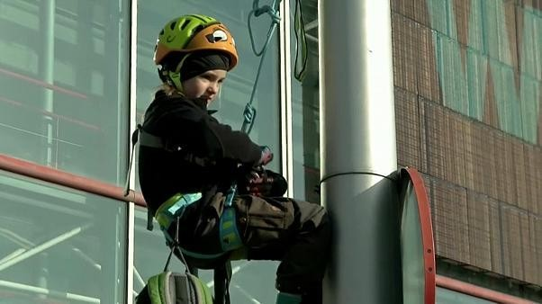 Eight-year-old climate activist climbs lamp post to protest outside COP25
