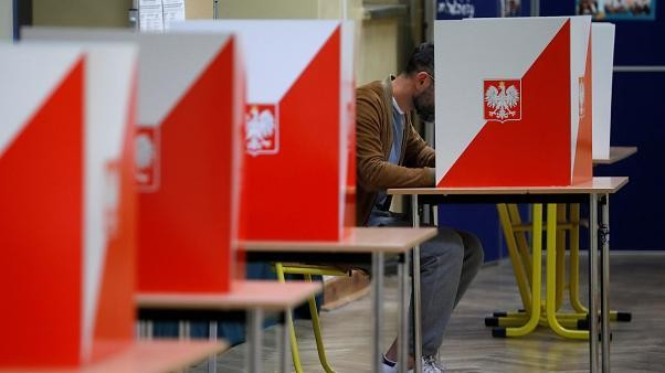 Poland heads to the polls with conservative ruling Law & Justice party in the lead