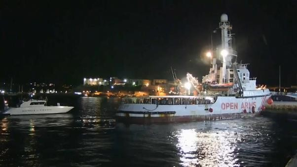 Migrants on board Open Arms rescue ship disembark at port of Lampedusa