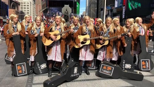 Dozens of Phoebe from Friends look-alikes perform in New York