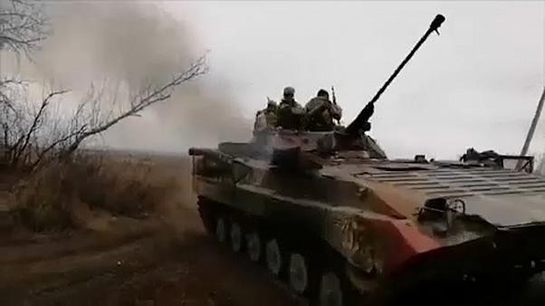 Ukraine's army and Russian-backed separatists pull back from village in eastern region
