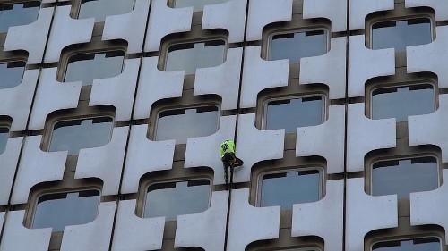 'French Spider-Man' Alain Robert scales Paris skyscraper