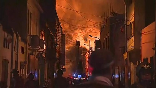 Huge fire engulfs downtown Lima