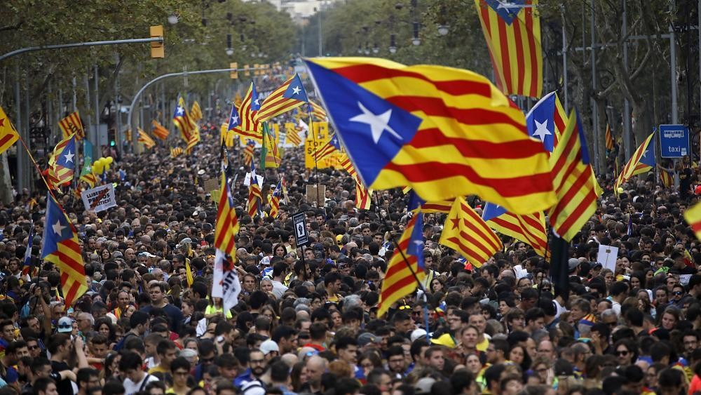 Spanish police arrest 21 people in raids on Catalan separatists