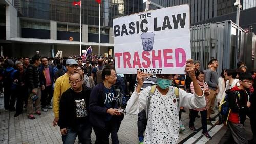 Hands off Hong Kong, protesters warn China