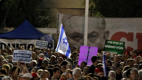 Thousands of Israelis protest legislative changes to grant PM immunity and limit Supreme Court