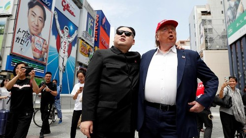 The impersonators of Kim Jong Un and Donald Trump greeted crowds in a shopping area in Osaka, two days before world leaders are set to meet at the G20 summit.