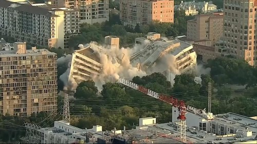 Drone footage shows bank building imploding in Dallas, Texas