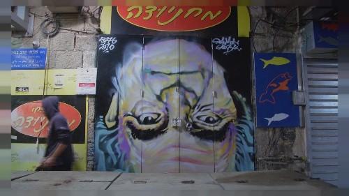 Graffiti art comes to life at night in Jerusalem market