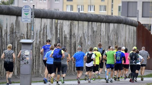 Runners brave ultra-marathon to commemorate fall of Berlin wall