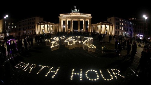 World landmarks switch the lights off to mark Earth Hour