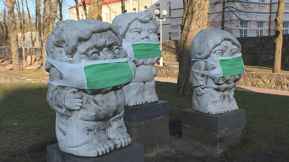 Masked statues comment on culture and health in Lithuania