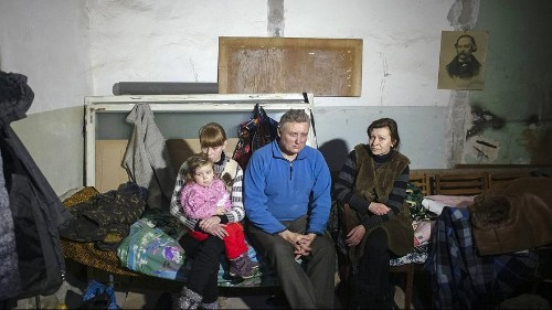 Ukraine's parliament argues about ceasefires as more refugees arrive from the east