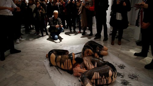 Oil on canvas: Semi-naked climate activists protest BP art sponsorship