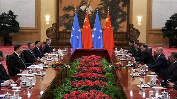 Why is this tiny Pacific Ocean nation getting VIP treatment in Beijing?