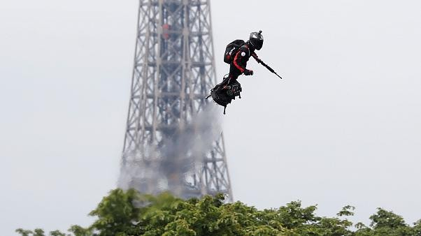 Macron 'proud' as jet-powered flyboard steals show at Bastille Day parade #14juillet