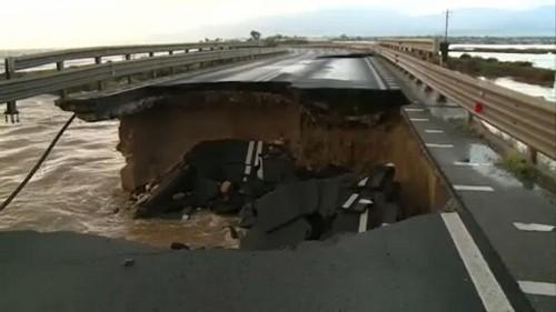 Flooding in Sardinia causes bridge collapse