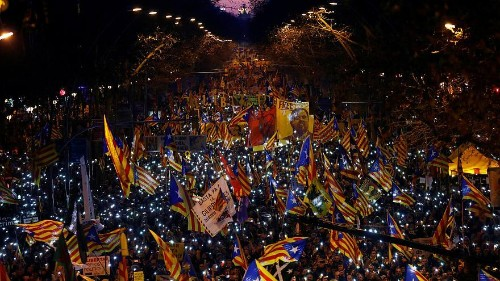 Riot police clash with protesters over Catalan separatists trial