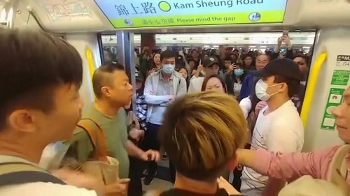 Train scuffles and Christmas tree alight as Hong Kong protests go on