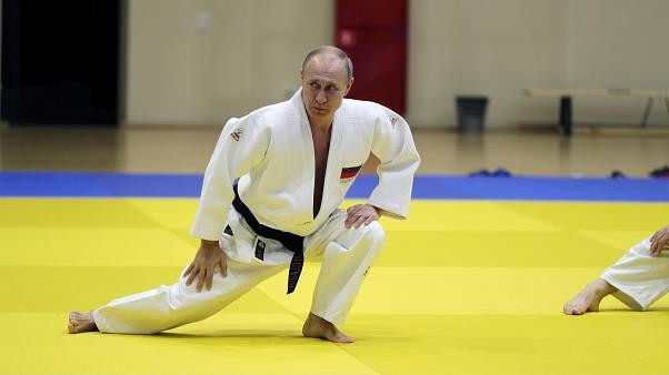 Black belt Putin shows off judo moves with Olympic athletes