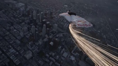 Wingsuits swoop over Los Angeles skyscrapers during supermoon night sky