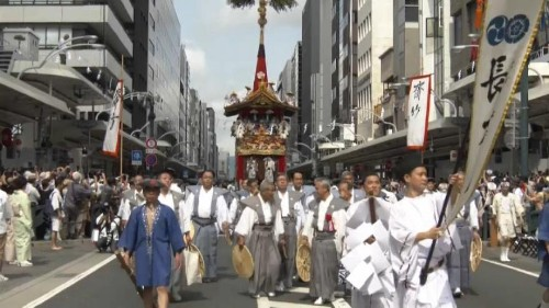 Ornate floats parade through the streets of Kyoto at Gion Festival