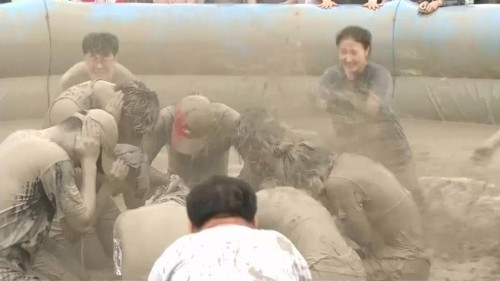 South Korea mud festival offers respite from heat and... effective skincare