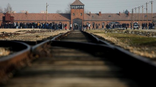 Auschwitz visitors told not to balance on train tracks for photos