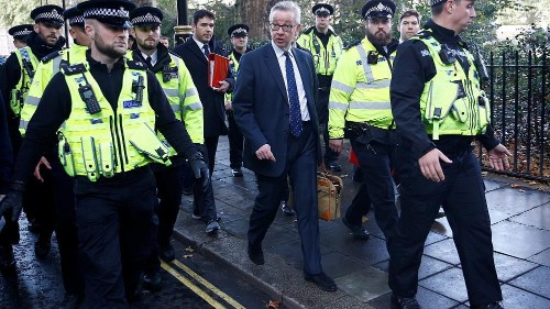 Pro-EU protesters shout at British ministers leaving parliament