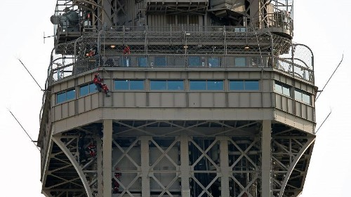 Eiffel Tower evacuated after man climbs on structure