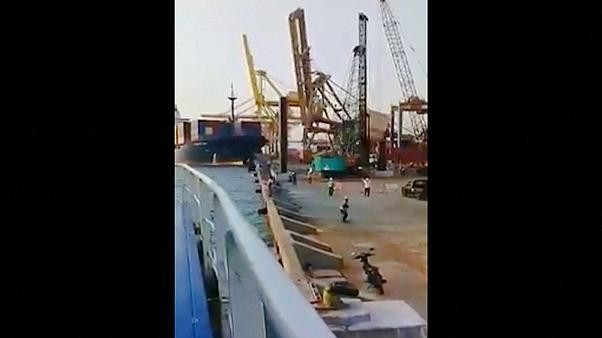 Container ship crashes into gantry crane in Indonesia