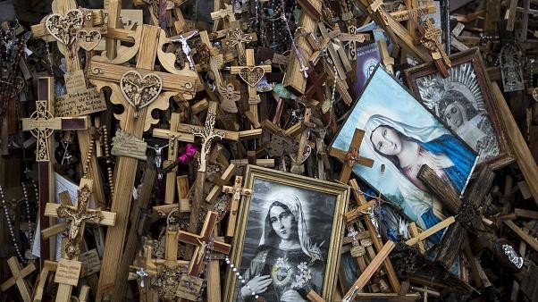 Chinese tourist vandalises cross at Lithuania's top tourist site